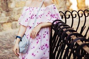 Woman in light pink trendy dress