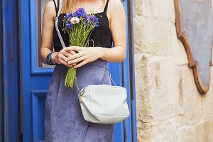 Woman with bouquet of cornflowers