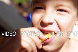Boy enjoying fries snack at the beach