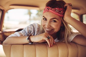 Smiling woman on a road trip
