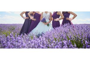 Girlfriends of the bride and bride in the field of lavender