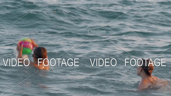 Mother With Son Bathing In Wavy Sea