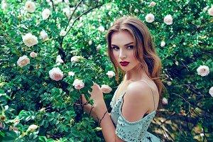 Girl near white roses.