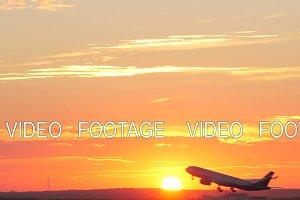 Plane taking off at golden sunset