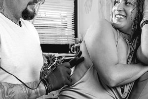 tattoo artist and customer