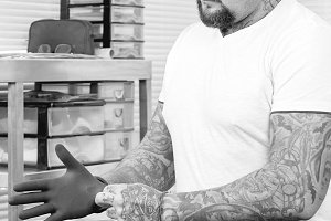 tattoo artist putting on the gloves