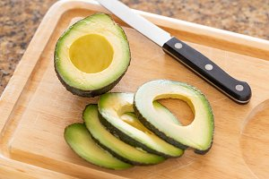 Fresh Cut Avocado on Wooden Cutting