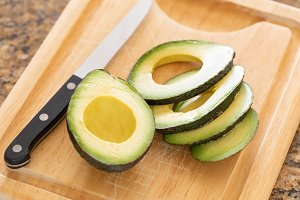 Fresh Cut Avocado on Cutting Board