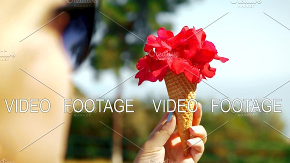 Woman Holding Red Flowers In Waffle Cone