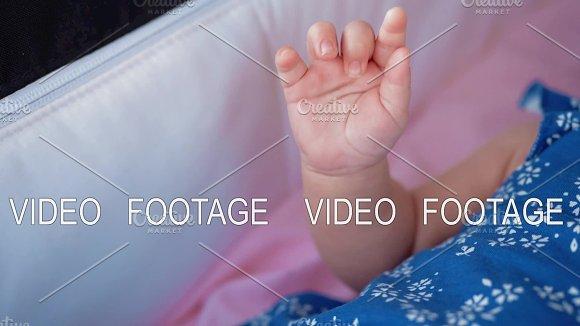 Baby In Pram Moving Her Hand