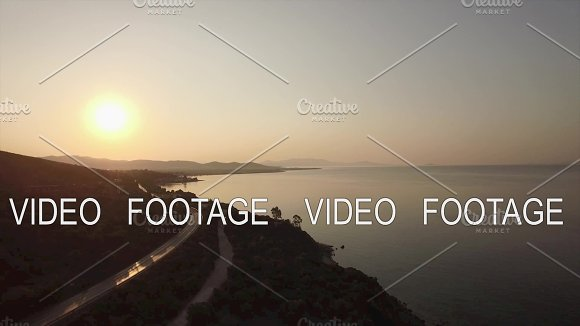 Aerial View Of Sea Waterfront Road And Upland Landscape At Sunset Greece