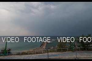Timelapse of cloudscape, sea and quay in Greece