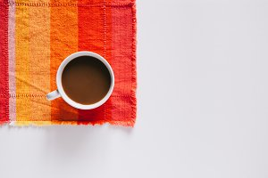Mug of Coffee on Colorful Placemat