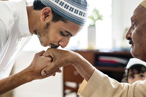 Muslim son kisses his father's hand