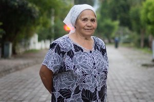 Portrait of beautiful senior woman at the summer park alley