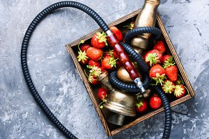 Stylish oriental shisha with strawbe