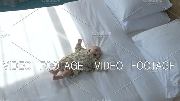 Cute Baby Girl On White Bed Linen