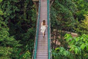 Young woman at the Suspension bridge in Kuala Lumpur, Malaysia