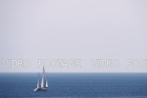 Scene with sky, sea and sailing yacht