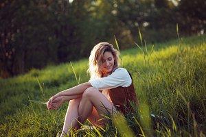 woman in white shirt enjoying picnic