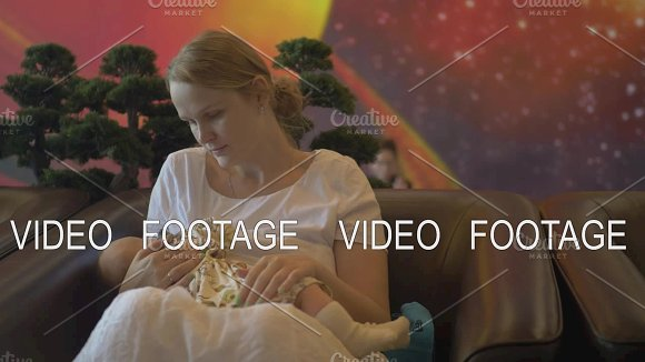 Woman Breastfeeding Baby In Airport Lounge