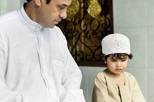 Muslim boy with his father