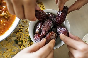 Family sharing a bowl of dates