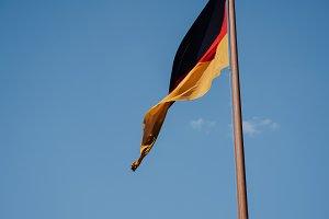 German national flag on blue sky background