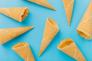 Empty waffle cones on blue