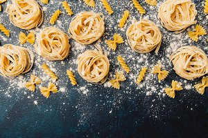 Various pasta scattered in flour