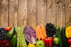 Different tasty vegetables on wooden