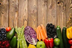 Different tasty vegetables on wooden