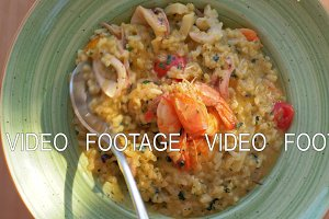 Dining at the restaurant with sea food risotto