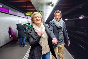 Senior couple at the underground platform, waiting