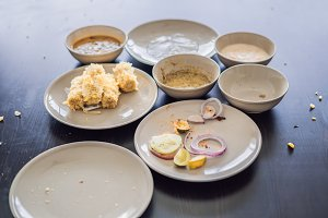 Plates with crumbs of food. Remains of food in plates after lunch or dinner
