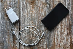 White charger and black smartphone