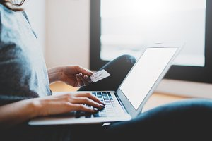 Girl paying online via internet