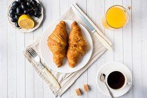 Coffee Croissant Orange juice Grape