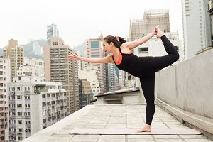 Asian Girl doing Yoga on a Rooftop