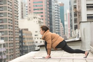 Stretching on a Rooftop before Yoga
