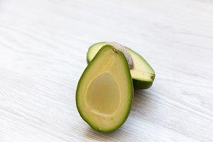 Avocado on white wooden background