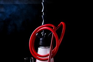 Stylish oriental shisha with fruits on a black background. Shisha Concept