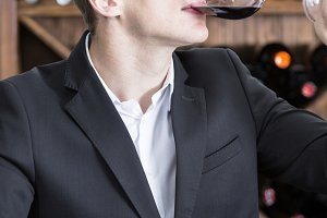winemaker tasting a red wineglass