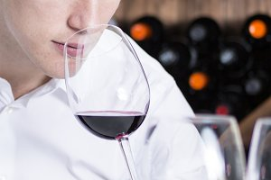winemaker smelling a red wineglass