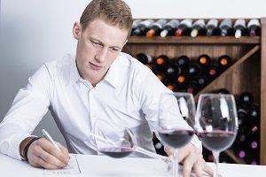 winemaker examining a wine glass