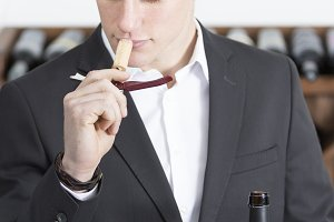 man smelling a cork