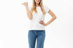 Young attractive happy woman in casual cloth pointing at white copy space background
