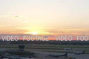 View of airport at sunset, plane taking off