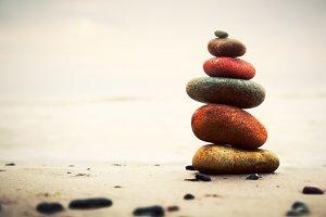 Stones pyramid on sand
