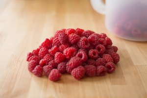 Raspberries on Wooden Table